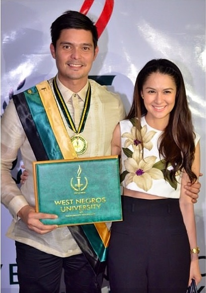 Dingdong Dantes with Marian Rivera at his graduation rites.