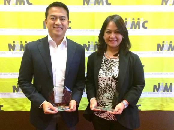 Joseph Francia, GMA Vice President and Head of International Operations, and Grace Labaguis, GMA marketing consultant receiving the awards for GMA Network