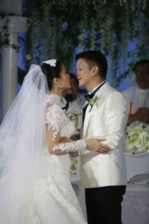 Chiz leans in to kiss his bride